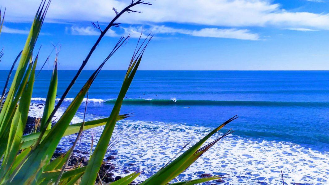Surfing at Manu Bay Raglan New Zealand